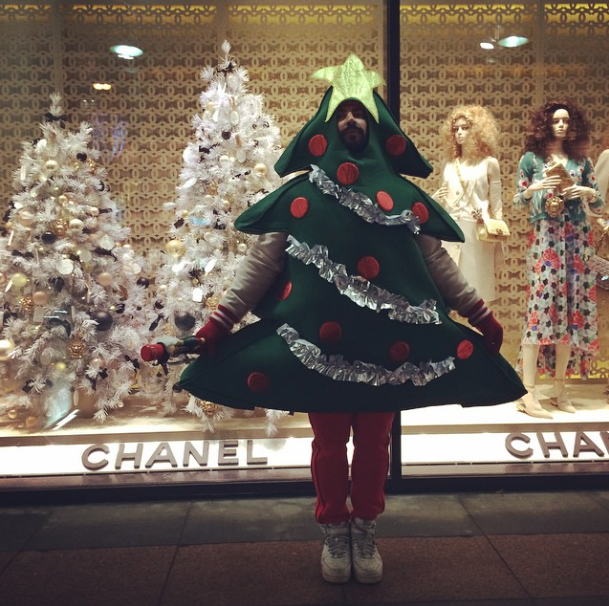 Petel poses in front of Chanel as a Christmas Tree